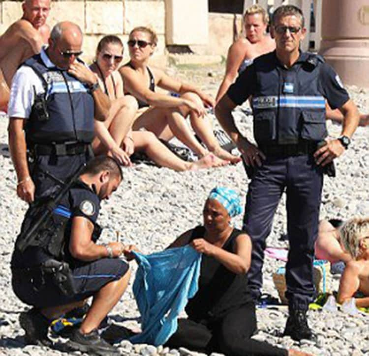10 photos about the burkini ban in france that point out the