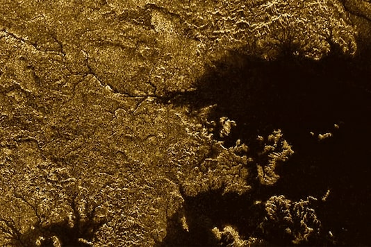 NASA's Cassini spacecraft pinged the surface of Titan with microwaves, finding that some channels are deep, steep-sided canyons filled with liquid hydrocarbons. One such feature is Vid Flumina, the branching network of narrow lines in the upper-left quadrant of the image. Image: NASA/JPL-Caltech/ASI