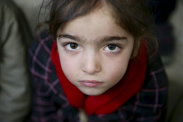 Gharam, 5, an orphan, attends a gathering organized by Damascus Lovers, a group that helps with social support for orphans, in Harasta