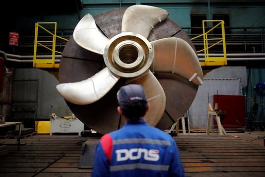 An employee looks at the propeller of a Scorpen submarine at the industrial site of the naval defence company and shipbuilder DCNS (Reuters)