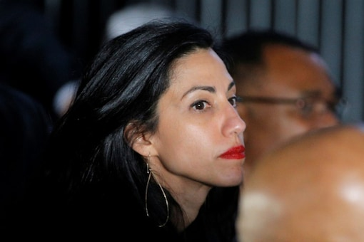 Huma Abedin, longtime aide to Hillary Clinton, attends a Clinton campaign rally in Charlotte, North Carolina, US (Reuters)