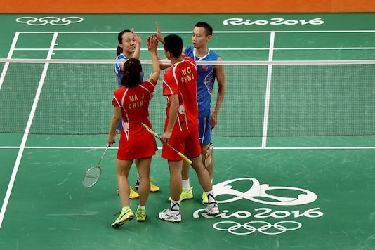 Yunlei Zhao and Nan Zhang of China are congratulated for their bronze medal Mixed Doubles win by Chen Xu and Jin Ma of China. (Getty Images)