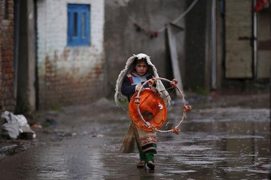 A girl carrying a baby walker walks in an alley. (Representative Image: Reuters)