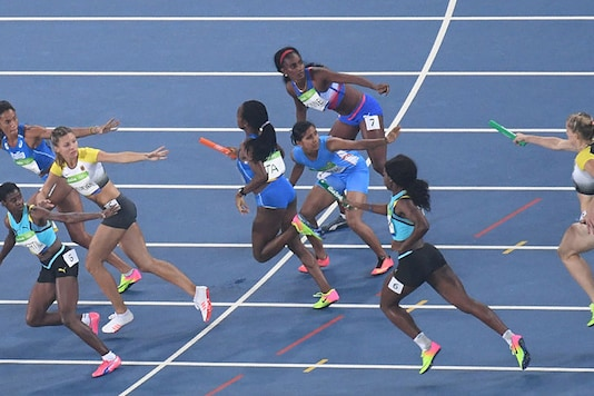 Athletes compete in the Women's 4x400m Relay Round. (Getty Images)