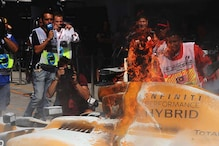Rosberg Tops Malaysian GP Practice, Magnussen Catches Fire