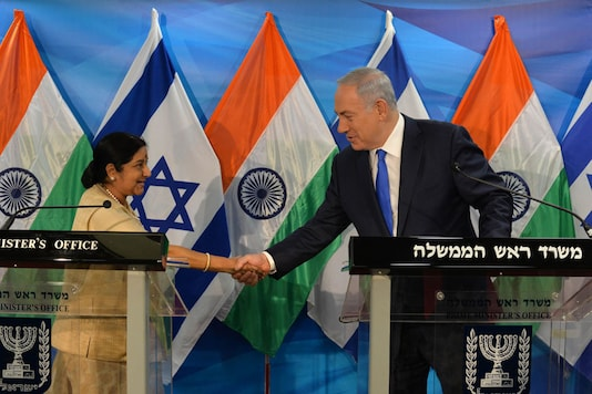 File photo of Israeli Prime Minister Benjamin Netanyahu shaking hands with Sushma Swaraj, External Affairs Minister of India. (Photo Credit: Getty Images)
