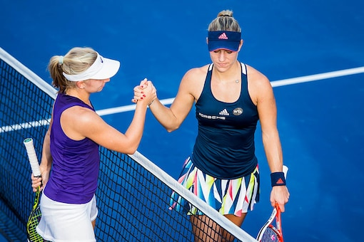 Angelique Kerber (R) of Germany and Daria Gavrilova of Australia shake hands. (Getty Images)