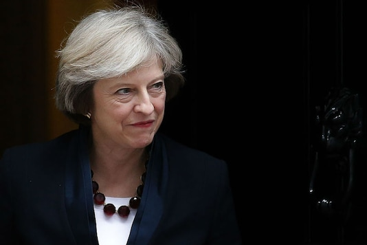 Theresa May was also accused by opponents of failing to stand up to the United States over its withdrawal from the Paris climate accord. (GETTY IMAGES)