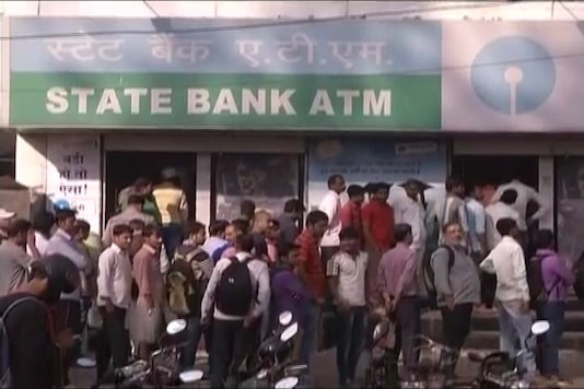 People waiting their turn in a queue to withdraw money from an ATM.(Representative image)