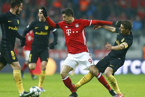 Bayern Munich's Robert Lewandowski in action with Atletico Madrid's Gabi.  (Reuters Images)