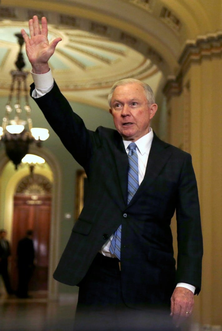 President-elect Trump's nominee for Attorney General, Senator Sessions waves to reporters after McConnell meeting on Capitol Hill in Washington