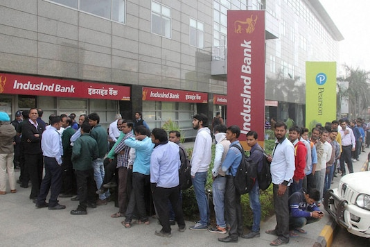 People queue up outside a bank to withdraw cash  (PTI Photo)