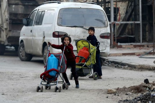 Children push containers in strollers as they flee deeper into the remaining rebel-held areas of Aleppo, Syria December 12, 2016.  (Photo: Reuters)