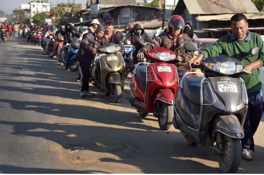 People stand in a queue for fuel at a petrol pump in Imphal, which has been suffering from the economic blockade imposed by some of the Naga tribal groups since November. (Photo: PTI)