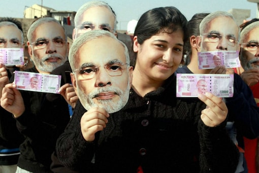 Demonetisation supporters wear Modi masks at a rally in Jammu. (PTI Photo) Representative image