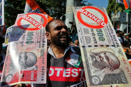 A man holds placards and shouts slogans during a rally organised by the Congress in Mumbai on November 28, 2016. (REUTERS)