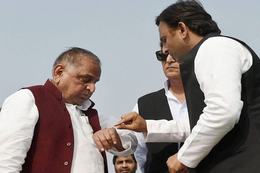 File photo of Mulayam Singh Yadav with Akhilesh Yadav during a function in Uttar Pradesh. (PTI Photo)