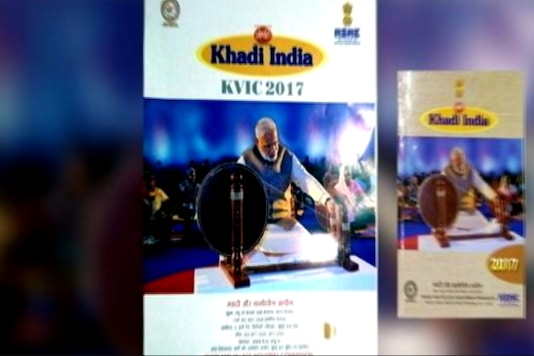 A TV grab of Prime Minister Narendra Modi on the Khadi calendar .