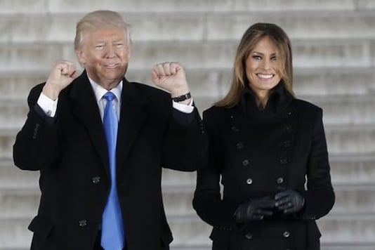 US President-elect Donald Trump acknowledges supporters with his wife Melania at the