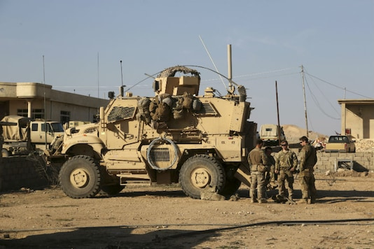 US Army soldiers stand outside their armored vehicle (File photo)