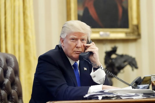 File photo, U.S. President Donald Trump speaks on the phone with Prime Minister of Australia Malcolm Turnbull in the Oval Office of the White House in Washington (Reuters)