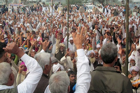 Jat  protestors sitting on a dharna demanding reservations in government jobs in Hisar (PTI Photo)
