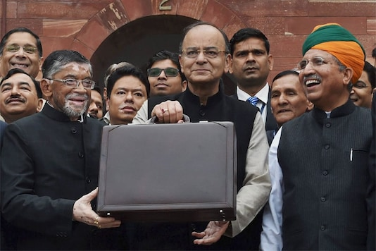 Finance Minister Arun Jaitley (C) stands outside his office at North Block holding the briefcase containing the Union budget for 2017 (PTI Photo)