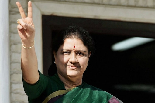 AIADMK General Secretary VK Sasikala flashes a victory sign after attending the party MLAs' meeting in which she was elected AIADMK Legislative Party leader in Chennai on February 5. (PTI Photo by R Senthil Kumar)