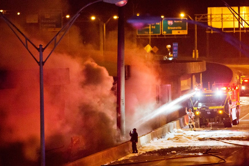 Smoke billows from a section of an overpass that collapsed from a large fire on Interstate 85 in Atlanta (AP)
