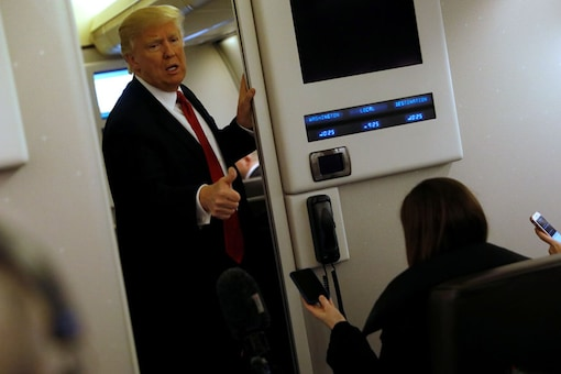US President Donald Trump speaks to reporters aboard Air Force One as they approach Joint Base Andrews, Maryland, U.S. Photo: Reuters