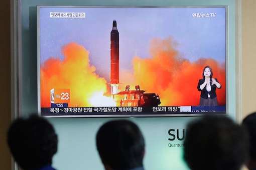File photo of people watching a TV news channel airing an image of North Korea's ballistic missile launch. (Photo credit: AP)