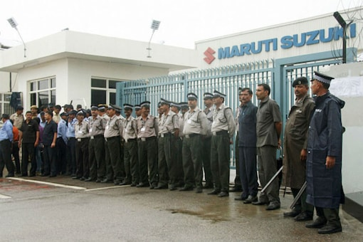 Security guards stand in front of Maruti Suzuki India Ltd. Plant in Manesar: (File photo)