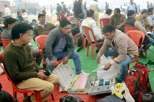 Election officials check EVMs. (Image: PTI)