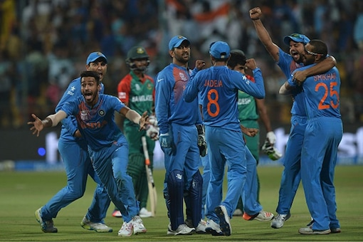 The Indian players celebrate after the hosts beat Bangladesh by 1 run in a WT20 match at Bangalore on March 23, 2016 (Getty Images)