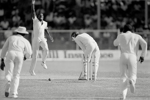 Curtly Ambrose celebrates the dismissal of Jack Russell bowled for 55. (Getty Images)