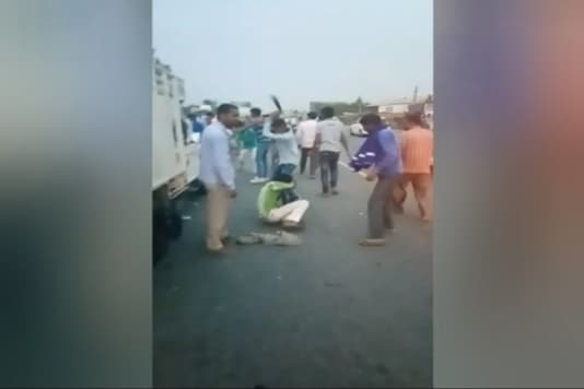TV grab of alleged cow vigilantes beating cattle transporters in Alwar, Rajasthan.