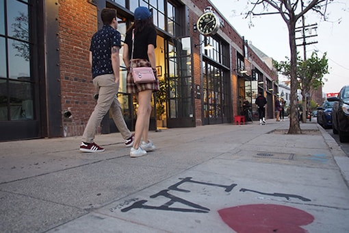 People walk on Traction Street, one of the main streets in downtown Los Angeles' burgeoning Arts District. (Photo courtesy: AFP Relaxnews/ Robyn Beck)