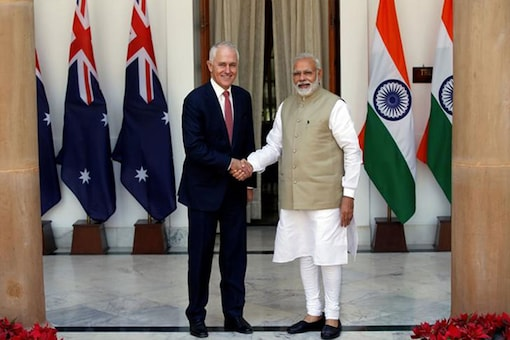 Australia's Prime Minister Malcolm Turnbull (L) shakes hands with his Indian counterpart Narendra Modi during a photo opportunity ahead of their meeting at Hyderabad House in New Delhi. (Image: Reuters)