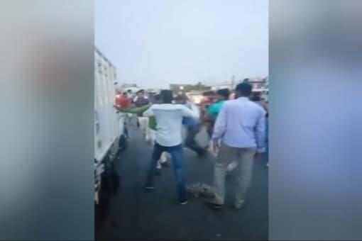 Gau rakshaks beating the cattle transporters in Rajasthan. A Muslim man later died in hospital. Screen grab credit: CNN-News18