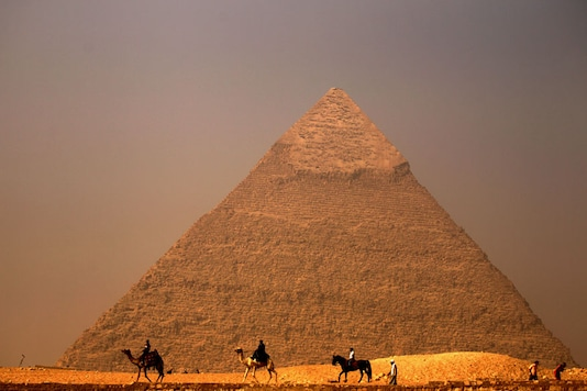Khufu and Khafre (seen here) in Giza along with the Bent and Red pyramids in Dahshur are part of Operation ScanPyramids, with teams scanning the structures in search of hidden rooms and cavities. (Photo courtesy: AFP Relaxnews/ PATRICK BAZ)