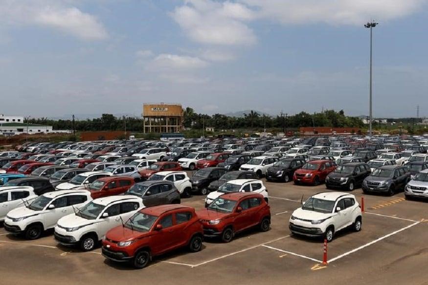 Vehicles are parked at the Mahindra & Mahindra manufacturing plant in Chakan. (Image: Reuters)