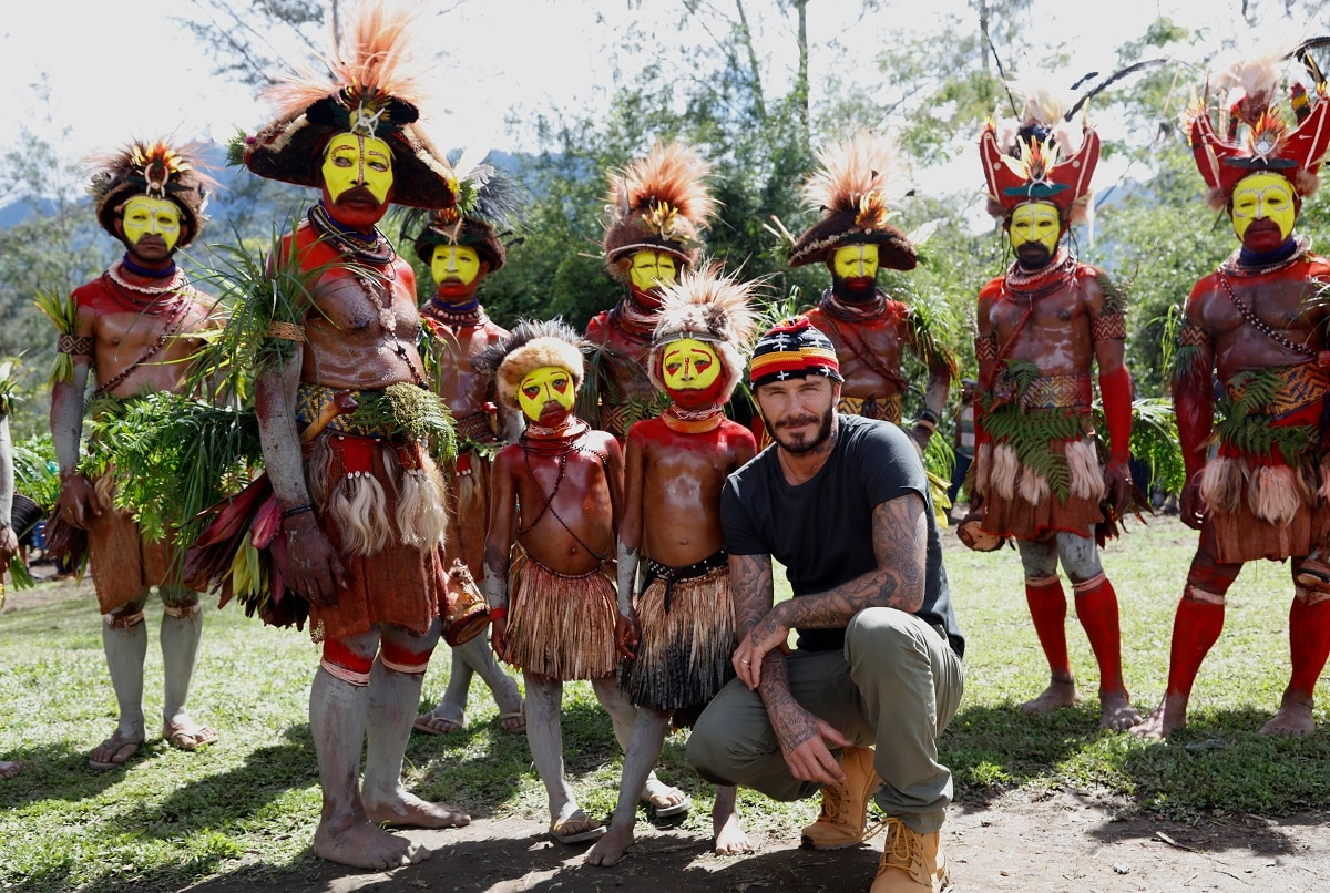 David Beckham stops to take a photograph with the indigenous tribesmen in Kur Kur, Western Highlands Province, Papua New Guinea. (Image Courtesy: BBC)