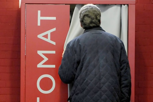 A man stands in front of the installation 'prayomat' (Gebetomat) of artist Oliver Sturm in Berlin. (Photo courtesy: AP)