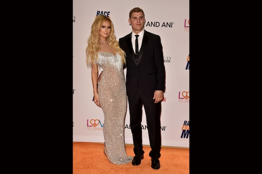 Paris Hilton and actor Chris Zylka attend the 24th Annual Race To Erase MS Gala at The Beverly Hilton Hotel on May 5, 2017 in Beverly Hills, California. (Images: Getty Images)