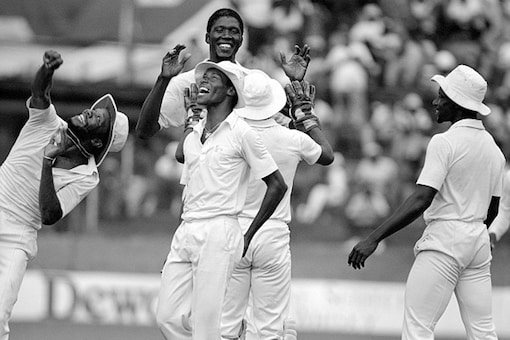 West Indies cricketers Malcolm Marshall, Carlisle Best, Joel Garner, Thelston Payne and Richie Richardson celebrate a wicket. (Getty Images)