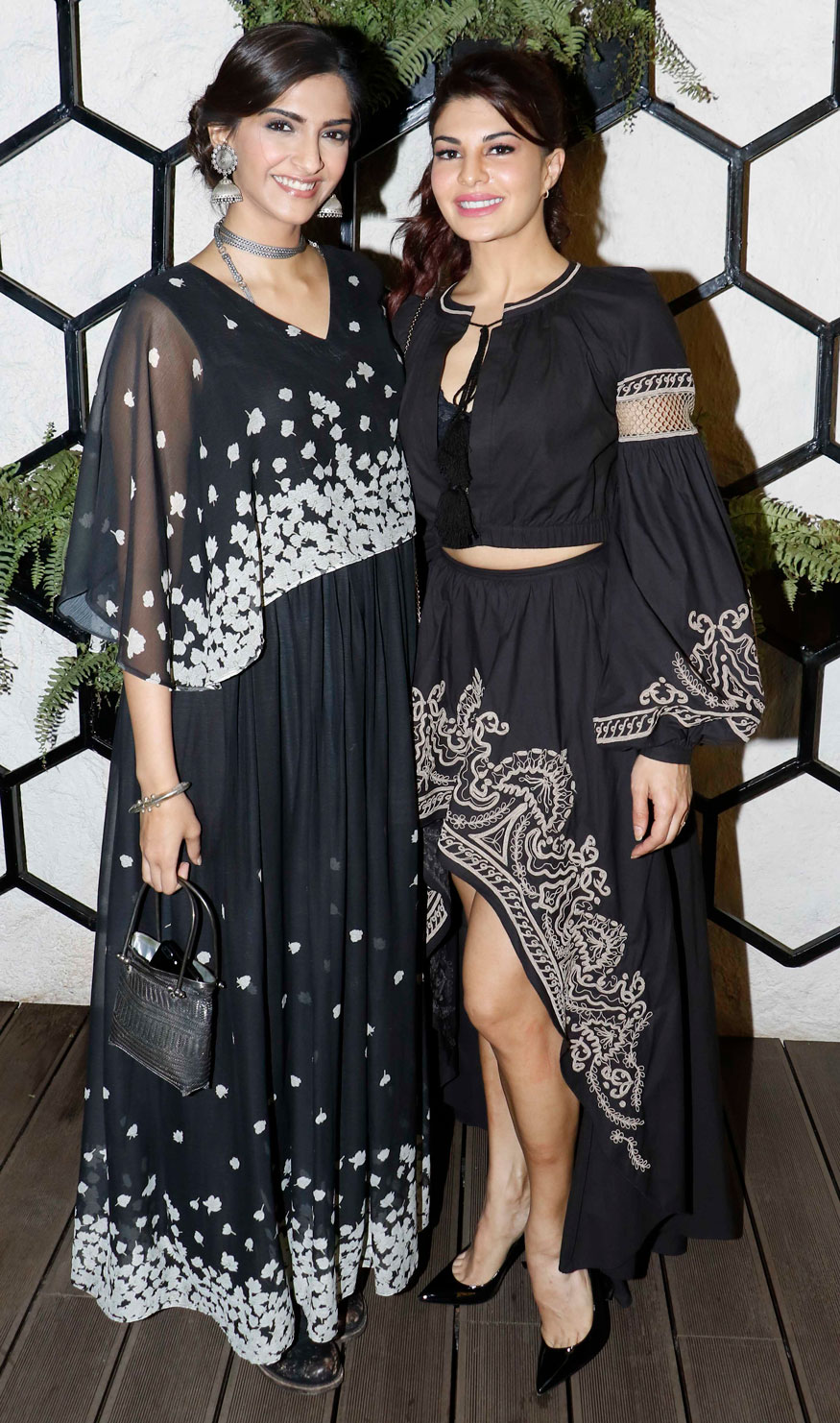 Sonam Kapoor and Jacqueline Fernandez pose for photographers upon arrival at the opening of restaurant 'Arth' designed by Gauri Khan. (Image: Yogen Shah)