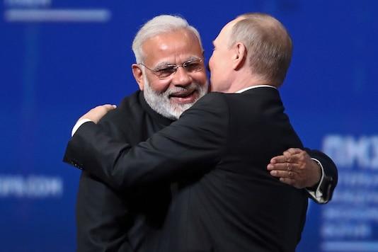 File photo of Russian President Vladimir Putin, right, and Indian Prime Minister Narendra Modi.