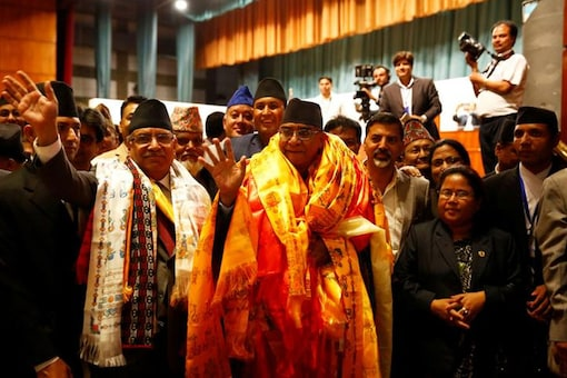 Nepal's newly elected Prime Minister Sher Bahadur Deuba (C), next to outgoing Prime Minister Pushpa Kamal Dahal also known as Prachanda (L), waves towards media personnel after being elected for the Prime Minister as they walk out from the Parliament in Kathmandu, Nepal June 6, 2017.