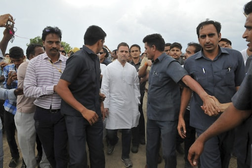 Rahul Gandhi walks to meet relatives of farmers killed at a rally in Madhya Pradesh on Tuesday after he arrived at Nimbahera village in Chittorgarh, Rajasthan, on Thursday. (AP Photo)