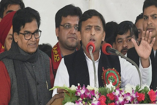 File photo of former Uttar Pradesh CM Akhilesh Yadav with Ram Gopal Yadav. (Photo: PTI)
